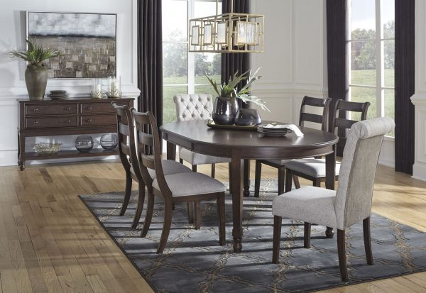 Adinton - Reddish Brown - 7 Pc. - Oval DRM EXT Table, 4 UPH Side Chairs & 2 Side Chairs