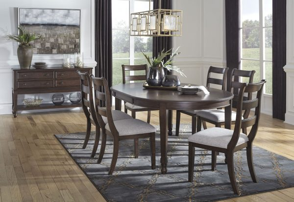 Adinton - Reddish Brown - 7 Pc. - Oval DRM EXT Table & 6 UPH Side Chairs